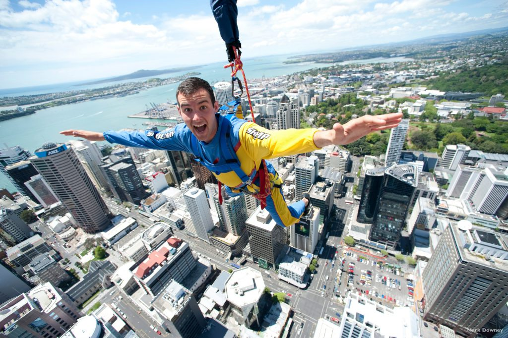 Man hanging from Sky Tower Auckland New Zealand